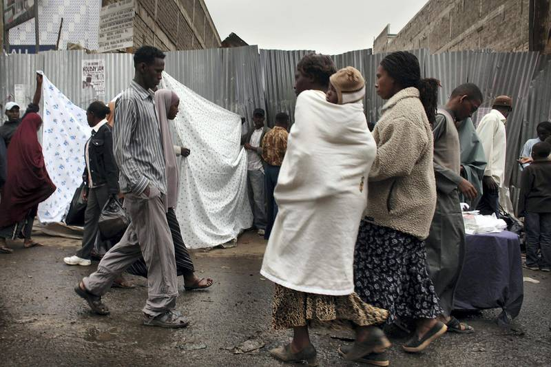 """NAIROBI, KENYA - AUGUST 18:  People walk down a market street in Eastleigh, a predominantly Muslim Somali neighborhood on August 18, 2009 in Nairobi, Kenya. Referred to locally as """"Little Mogadishu"""", Eastleigh is home to thousands of Somalis who have fled war-ravaged Somalia in recent years. Over 300,000 refugees have left Somalia and have headed to neighboring Kenya, with most residing in the overcrowded Kenyan camps of Dadaab. Kenyan officials and western security services are becoming increasingly concerned that radical Islamists, specifically members of Al-Shabaab, are also settling in the Eastleigh neighborhood where they could use it as a base to plan future attacks throughout the Horn of Africa. (Photo by Spencer Platt/Getty Images)"""