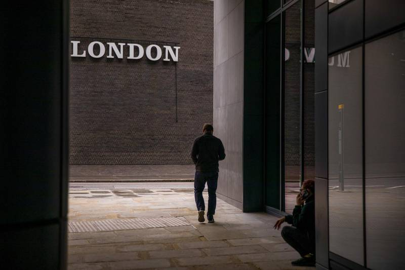 A pedestrian walks past a sign for the Museum of London in the City of London, U.K., on Monday, Oct. 12, 2020. The approach of Brexit has London confronting the loss of its role as Europe's undisputed stock-trading hub and, with it, billions of euros in daily trading. Photographer: Jason Alden/Bloomberg
