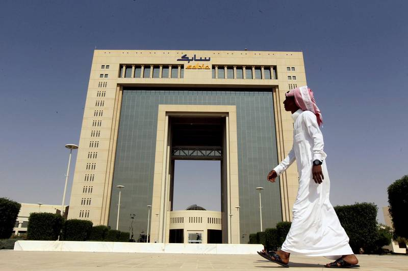 FILE PHOTO: A man walks past the headquarters of Saudi Basic Industries Corp (SABIC) in Riyadh, Saudi Arabia October 27, 2013. REUTERS/Faisal Al Nasser/File Photo