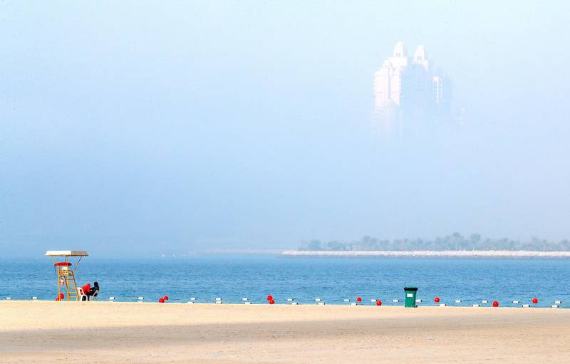 Abu Dhabi, United Arab Emirates, March 1, 2020.  Standalone:  The Fairmont Marina peeks through the fog on the Corniche, Abu Dhabi, on a sunny morning.Victor Besa / The NationalSection:  NAReporter: