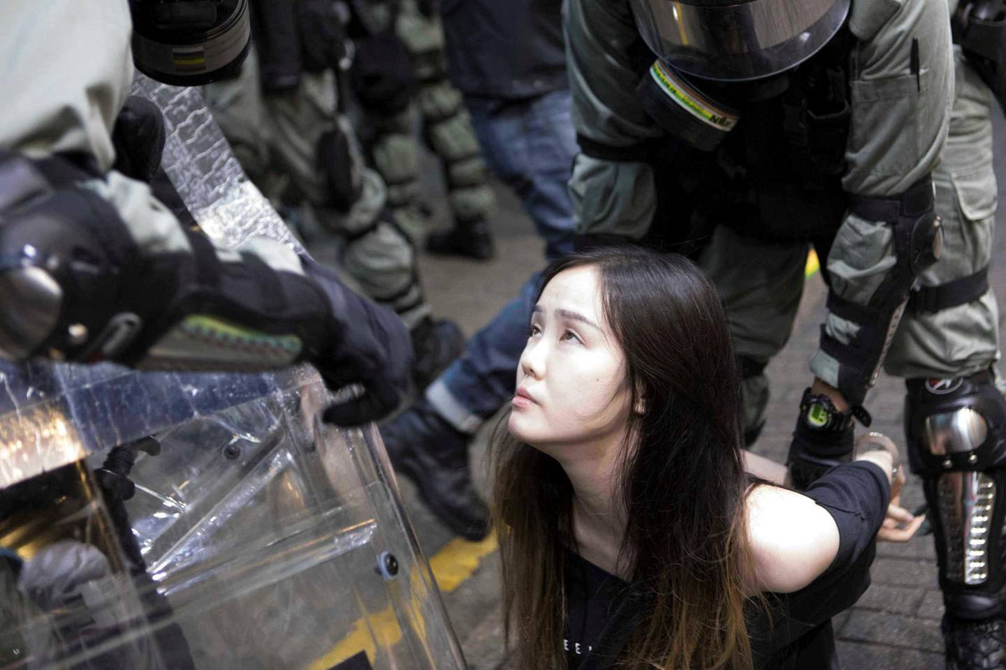 A young female demonstrator is arrested by police during clashes in the Causeway Bay area of Hong Kong. Rick Findler for The National