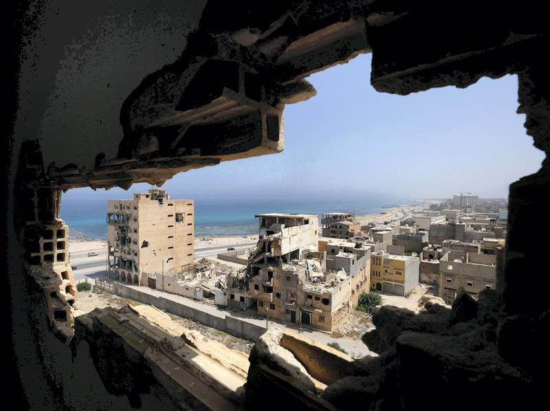 Destroyed buildings are seen through a hole in Benghazi lighthouse after it was severely damaged by years of armed conflict, in Benghazi, Libya July 10, 2019 . Picture taken July 10, 2019.  REUTERS/Esam Omran Al-Fetori     TPX IMAGES OF THE DAY