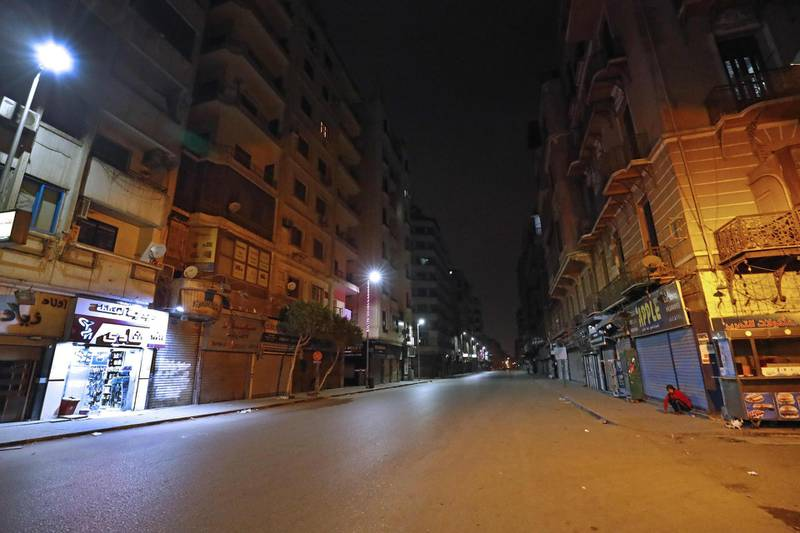 A street in the Egptian capital Cairo is deserted on the first day of a two-weeks night-time curfew imposed by the authorities to contain the spread of the novel coronavirus, on March 25, 2020.   / AFP / Khaled DESOUKI