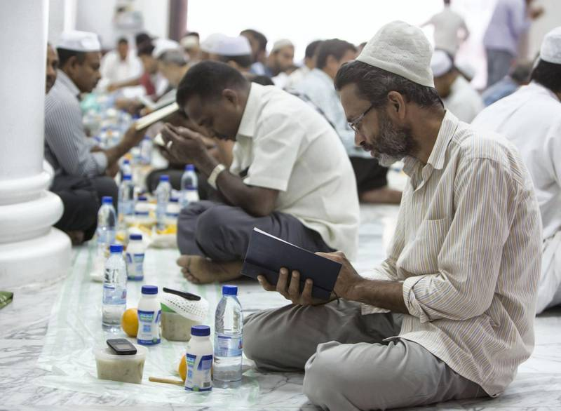 DUBAI,  UNITED ARAB EMIRATES, 20 May 2018 - Muslims praying before  iftar at Lootah Masjid Mosque, Deira, Dubai. Leslie Pableo for The National  for Ramola Talwar story