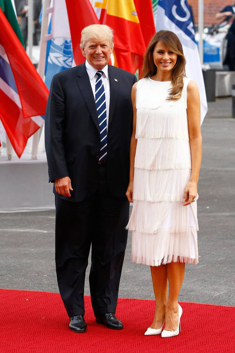 HAMBURG, GERMANY - JULY 07: US President Donald Trump and his wife Melania Trump arrive to attend a concert at the Elbphilharmonie philharmonic concert hall on the first day of the G20 economic summit on July 7, 2017 in Hamburg, Germany. The G20 group of nations are meeting July 7-8 and major topics will include climate change and migration. (Photo by Morris MacMatzen/Getty Images)