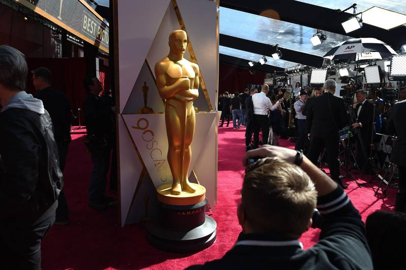"""(FILES) In this file photo taken on March 04, 2018 Photographers and TV crews get ready on the red carpet a few hours before the """"Oscars"""", the 90th Annual Academy Awards in Hollywood, California.  The 93rd Oscars have been postponed by eight weeks to April 25 after the coronavirus pandemic shuttered movie theaters and wreaked havoc on Hollywood's release calendar, the Academy said June 15, 2020. / AFP / Robyn BECK"""
