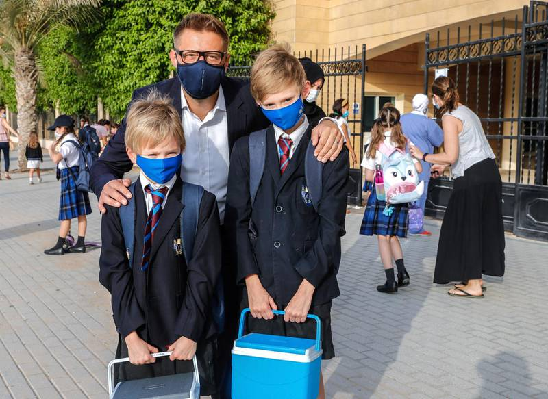 Abu Dhabi, United Arab Emirates, August 30, 2020.  Children return to school on Sunday after months off due to the Covid-19 pandemic at the Brighton College, Abu Dhabi. --  Stephen Haw and sons, Hugo, nine and Hector, seven.Victor Besa /The NationalSection:  NAReporter:  Haneen Dajani