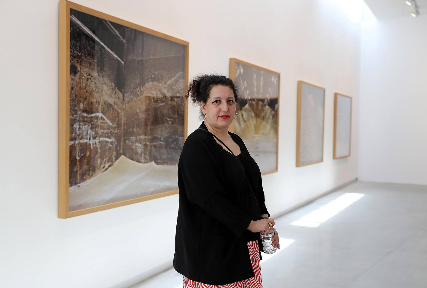 SHARJAH , UNITED ARAB EMIRATES , MARCH 15  – 2017 :- Zineb Sedira , artist with her work during the opening of the exhibition at Sharjah Art Foundation in Sharjah. ( Pawan Singh / The National ) For Arts & Life. Story by Melissa