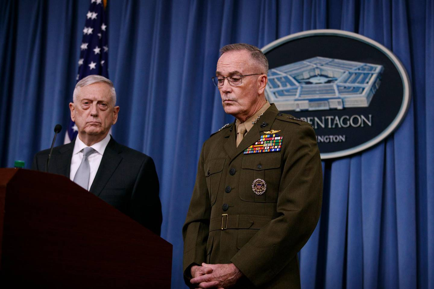 Defense Secretary Jim Mattis, joined by Joint Chiefs Chairman Gen. Joseph Dunford, speak at the Pentagon, Friday, April 13, 2018, on the U.S. military response, along with France and Britain, to Syria's chemical weapon attack on April 7. (AP Photo/Carolyn Kaster)