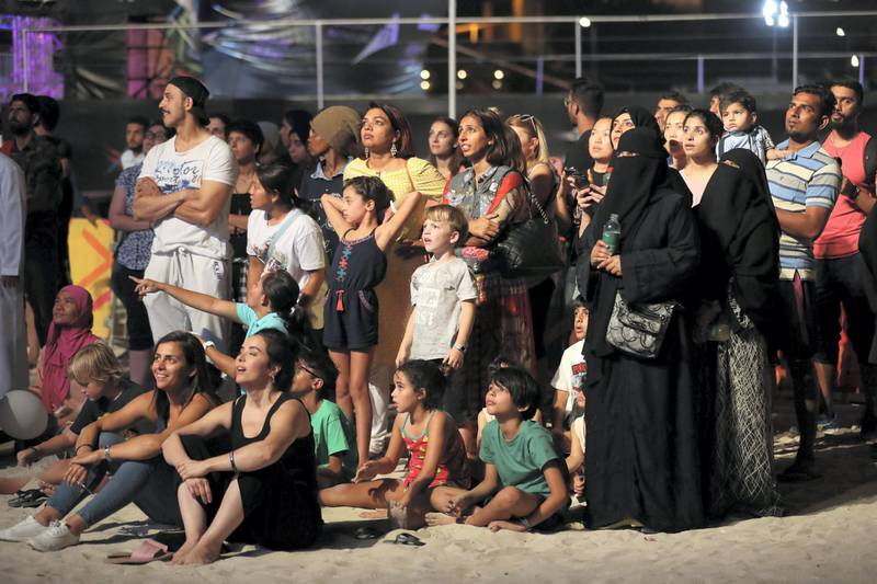 Dubai, United Arab Emirates - April 06, 2019: The crowd watches the big screen during the mens final of the Gov Games 2019. Saturday the 6th of April 2019. Kite Beach, Dubai. Chris Whiteoak / The National