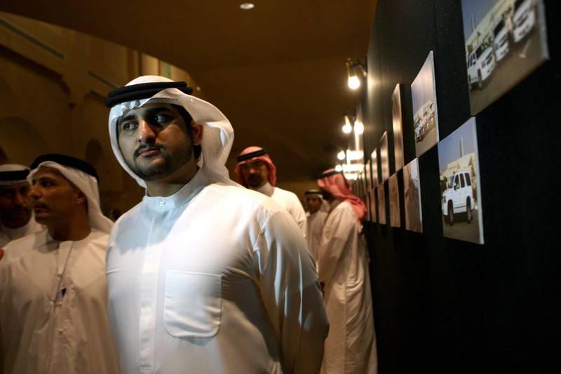 Abu Dhabi, UAE - June 04, 2008 - Sheikh Maktoum Bin Mohammad Bin Rashid Al Maktoum, Deputy Ruler of Dubai, inaugurated a trial program of 10 hybrid vehicles for Dubai's taxi fleet.  (Nicole Hill / The National) *** Local Caption ***  NH Green Taxi130.jpgNH Green Taxi130.jpg