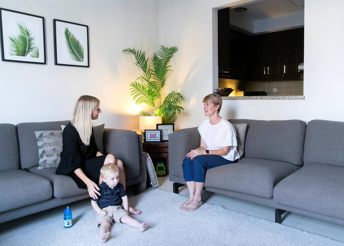 """DUBAI, UNITED ARAB EMIRATES. 31 OCTOBER 2019. Claudine Gillard, right, of Sweet Dreams Consulting, consults Kelly Allison on methods to help her put her 3 year old son, Jack, to sleep.Claudine offers """"sleep training"""" methods for families with babies and toddlers. The methods include gentle, parent-led approaches with the help of expert infant sleep consultants who condemn the traditional """"cry it out"""" methods of sleep training.(Photo: Reem Mohammed/The National)Reporter:Section:"""