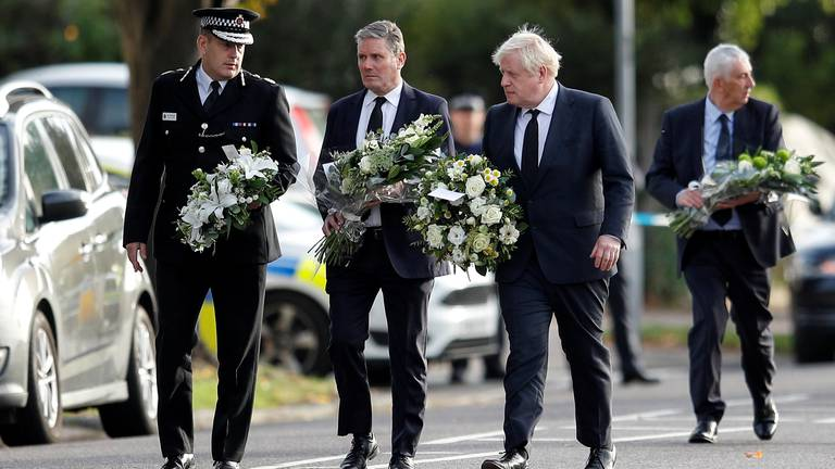 An image that illustrates this article Boris Johnson lays flowers at site of UK MP's murder