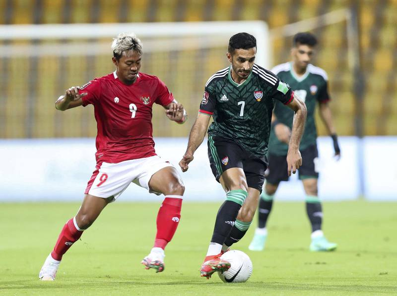 Ali Mabkhout of the UAE battles with Kushedya Hari Yudo of Indonesia during the game between the UAE and Indonesia in the World cup qualifiers at the Zabeel Stadium, Dubai on June 11th, 2021. Chris Whiteoak / The National.  Reporter: John McAuley for Sport