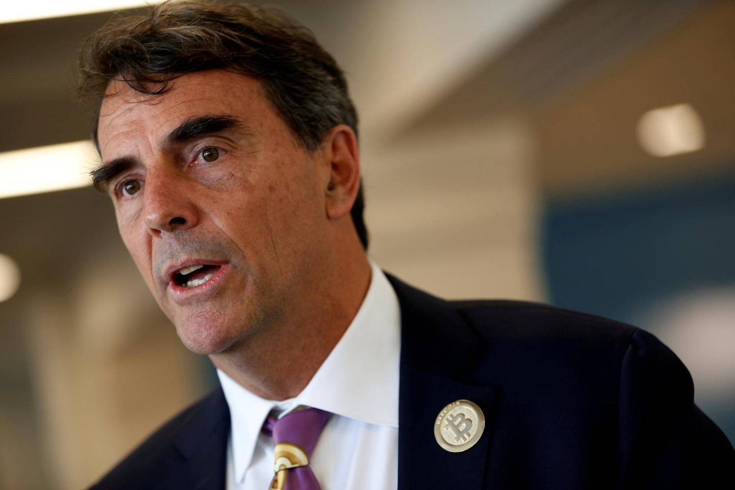 FILE PHOTO:    Venture capitalist and CAL 3 Chairman Tim Draper speaks during a press conference after announcing he has collected more than 600,000 signatures to put the plan to partition  California into three states into the November ballot in San Mateo, California, April 12, 2018. REUTERS/ Stephen Lam/File Photo