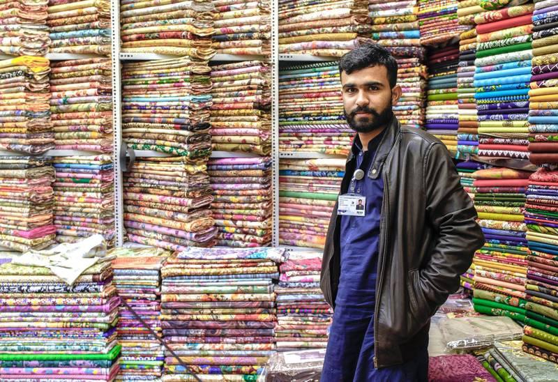 Abu Dhabi, United Arab Emirates, January 5, 2020.  --  Shazaib Beeba, 26, Pakistan, has benn working for a garments stall for 3 years now at the Pakistan Pavillion.Photo essay of Global Village.Victor Besa / The NationalSection:  WKReporter:  Katy Gillett