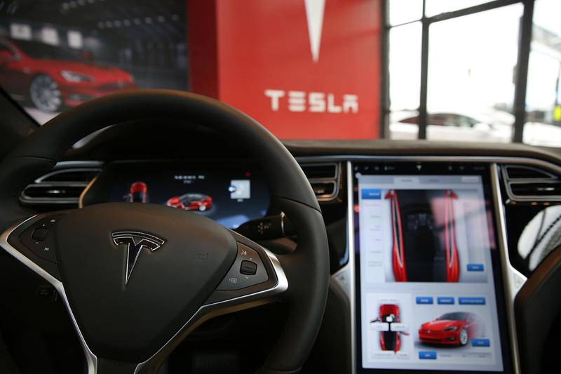 """(FILES) In this file photo taken on July 5, 2016 The inside of a Tesla vehicle is viewed as it sits parked in a new Tesla showroom and service center in Red Hook, Brooklyn in New York City.  The first driverless cars were supposed to be deployed on the roads of American cities in 2019, but just a few days before the end of the year, the lofty promises of car manufacturers and Silicon Valley remain far from becoming reality.  Recent accidents, such as those involving Tesla cars equipped with Autopilot, a driver assistance software, have shown that """"the technology is not ready,"""" said Dan Albert, critic and author of the book """"Are We There Yet?"""" on the history of the American automobile.  / AFP / GETTY IMAGES NORTH AMERICA / SPENCER PLATT"""