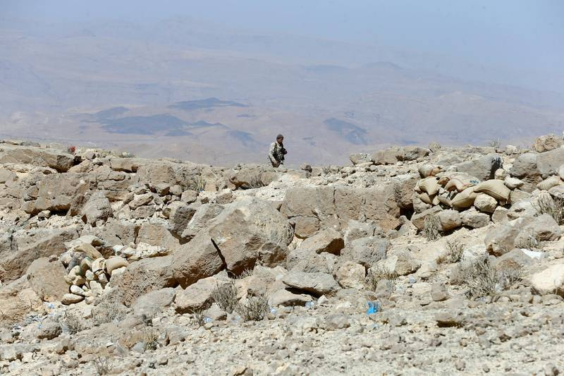 A Yemeni soldier walks on a mountain on the frontline of fighting with Houthis in Nihem area near Sanaa, Yemen January 27, 2018. Picture taken January 27, 2018. REUTERS/Faisal Al Nasser