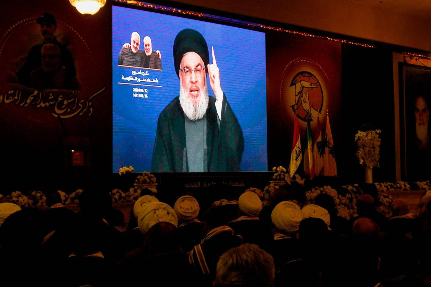 Supporters of the the Shiite Hezbollah movement watch as the movement's leader Hasan Nasrallah delivers a speech on a screen in the southern Lebanese city of Nabatieh on January 12, 2020.  / AFP / Mahmoud ZAYYAT