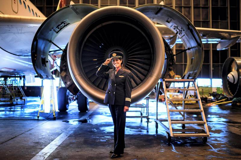 """To mark the occasion of International Women's Day on March 8, 2018 AFP presents a series of 45 photos depicting women performing roles or working in professions more traditionally held by men.  More images can be found in www.afpforum.com  Search SLUG  """"WOMEN-DAY -PACKAGE"""".  Ana Sousa, 45, TAP Air Portugal pilot for 11 years, poses for a portrait at a TAP hangar in Lisbon on February 28, 2018.  In the ring, battling flames or lifting off into space, women have entered professions generally considered as men's jobs. For International Women's Day, AFP met with women breaking down the barriers of gender-bias in the work world. / AFP PHOTO / PATRICIA DE MELO MOREIRA"""