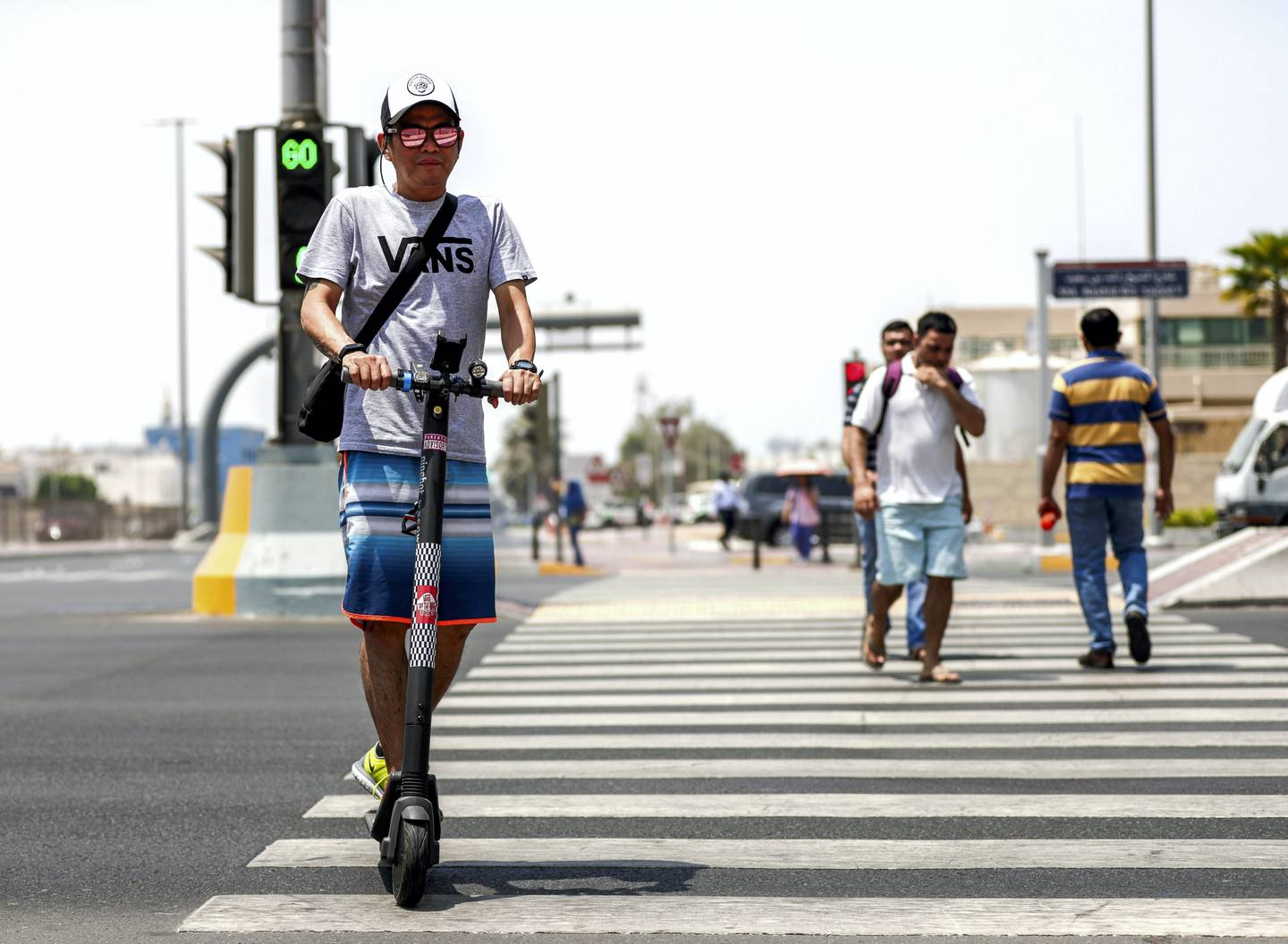 Abu Dhabi, United Arab Emirates, August 13, 2019.  People using E-scooters at the Al Wahda mall area, downtown Abu Dhabi. --  Perry Malapitan, takes an E-scooter everyday to work at downtown Abu Dhabi.Victor Besa/The NationalSection:  NAFOR:  Standalone