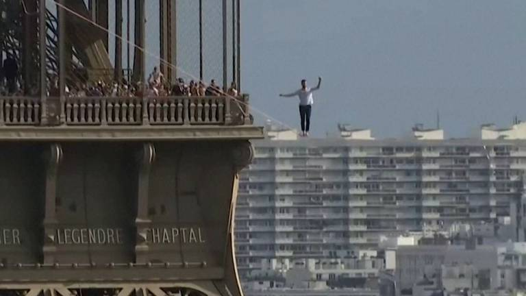 An image that illustrates this article French daredevil walks a 70-metre high slackline from the Eiffel Tower