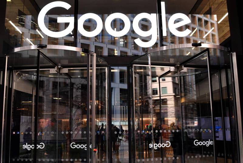 """(FILES) In this file photo taken on January 18, 2019 a logo is pictured above the entrance to the offices of Google in London. Google on June 16, 2020 confirmed that it booted one far-right website from its ad platform and put another on notice for hosting """"dangerous and derogatory"""" comments about civil rights protests. / AFP / Ben STANSALL"""