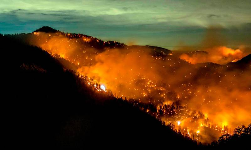 (FILES) In this file photo taken on September 17, 2020 the Bobcat Fire continues to burn through the Angeles National Forest in Los Angeles County, north of Azusa, California. The Pope and Prince William will join activists, artists, celebrities and politicians on Saturday at a free streamed TED event aimed at unifying people to confront the climate crisis. The Countdown program will kick off on the TED channel at YouTube starting at 8 AM in California and feature 50 speakers, the pontiff and the second-in-line to the British throne among them.  / AFP / Kyle Grillot