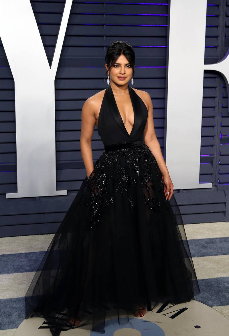 epa07396033 Priyanka Chopra poses at the 2019 Vanity Fair Oscar Party following the 91st annual Academy Awards ceremony, in Beverly Hills, California, USA, 24 February 2019. Black dress by Elie Saab Haute Couture. The Oscars are presented for outstanding individual or collective efforts in 24 categories in filmmaking.  EPA-EFE/NINA PROMMER