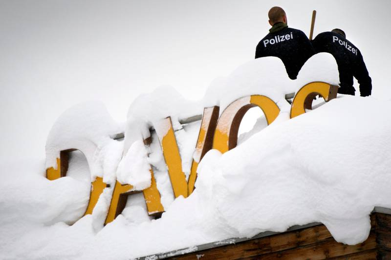Swiss police stand on the roof of the Kongress hotel next to the Congress Center ahead of the 48th annual meeting of the World Economic Forum, WEF, in Davos, Switzerland, Monday, Jan. 22, 2018. The meeting brings together entrepreneurs, scientists, chief executive and political leaders in Davos from January 23 to 26. (Laurent Gillieron/Keystone via AP)