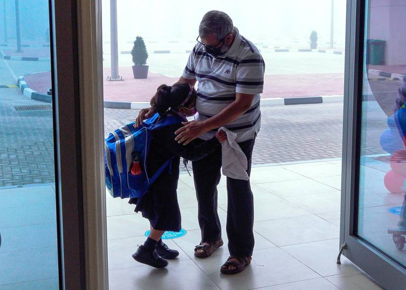 Abu Dhabi, United Arab Emirates, February 14, 2021. Pupils return to Abu Dhabi's private schools. GEMS United Indian School – Abu Dhabi.  A father drops off his daughter.Victor Besa/The NationalSection: NAReporter:  Anam Rizvi