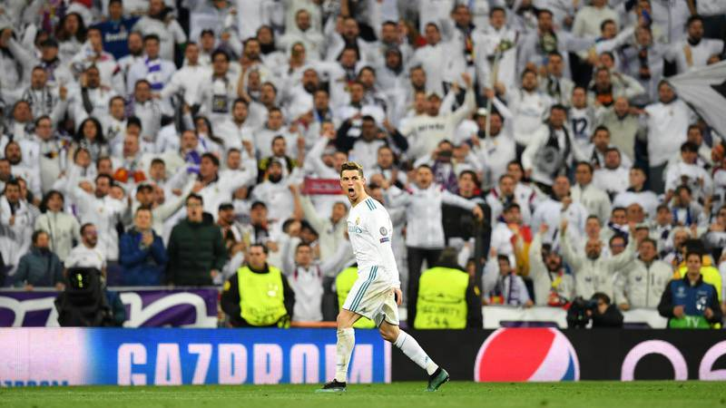 MADRID, SPAIN - APRIL 11:  Cristiano Ronaldo of Real Madrid celebrates after scoring his sides first goal during the UEFA Champions League Quarter Final Second Leg match between Real Madrid and Juventus at Estadio Santiago Bernabeu on April 11, 2018 in Madrid, Spain.  (Photo by Matthias Hangst/Bongarts/Getty Images)