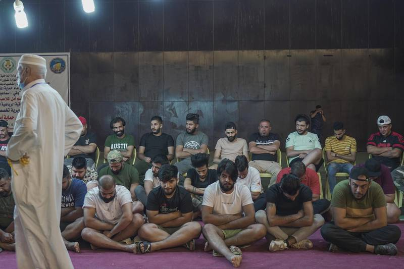 Players of Altobchi team hiding the ring amongst their team during the traditional ring tournament in Baghdad Iraq. Haider Husseini / The National