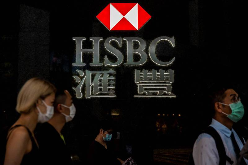 (FILES) In this file photo taken on September 21, 2020, pedestrians walk past the logo for HSBC in Hong Kong. HSBC announced on April 27, 2021 that first-quarter profits more than doubled, helped by a reversal in credit losses as well as its major restructuring and pivot to Asia. / AFP / ISAAC LAWRENCE