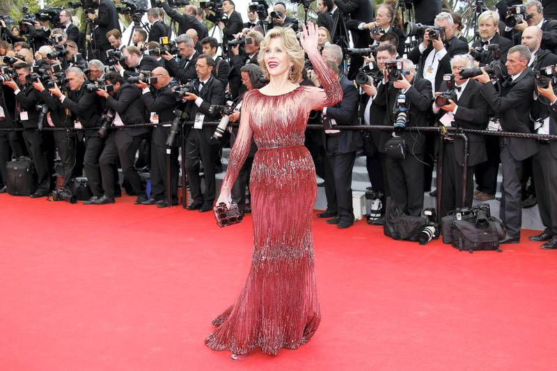 US actress Jane Fonda poses as she arrives for the Opening ceremony of the 67th edition of the Cannes Film Festival in Cannes, southern France, on May 14, 2014.        AFP PHOTO / VALERY HACHE (Photo by VALERY HACHE / AFP)