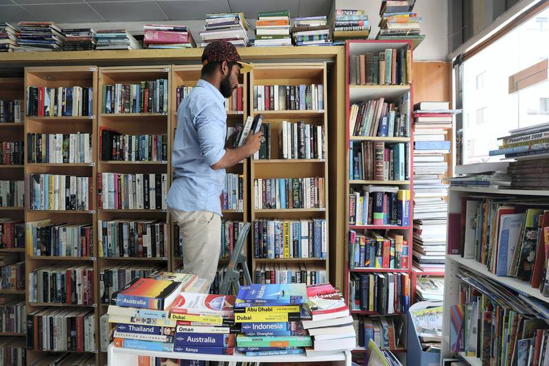 Abu Dhabi, United Arab Emirates - July 10th, 2018: Worker Fayiz Rahman. Thrift distribution and Books, Abu Dhabi's only secondhand bookshop. Tuesday, July 10th, 2018 in Abu Dhabi. Chris Whiteoak / The National