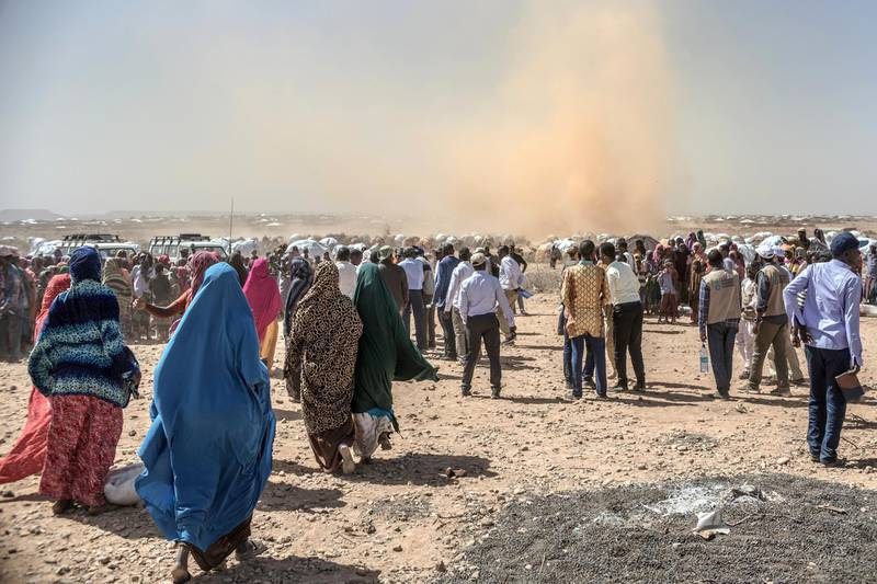 People gather prior to a food distribution at the Internally displaced person camp (IDP) of Farburo in Gode, near Kebri Dahar, southeastern Ethiopia, on January 27, 2018. - The camp recently hosted Somali families fleeing conflict between Somali and Oromo communities in Ethiopia. In Ethiopia's Somali region there are 264 sites largely populated by drought-displaced families. (Photo by YONAS TADESSE / AFP)