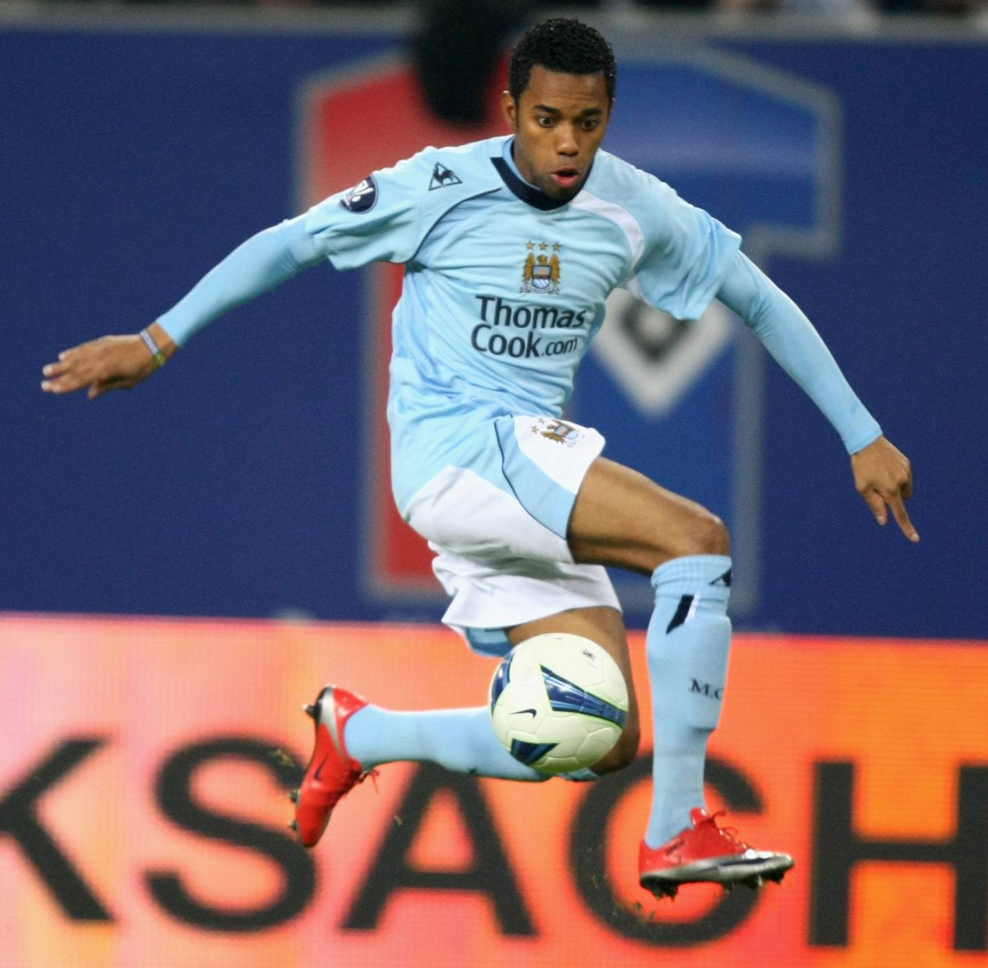 HAMBURG, GERMANY - APRIL 09:  Robinho of Manchester runs with the ball during the UEFA Cup quarter final first leg match between HSV Hamburg and Manchester City at the HSH Nordbank Arena on April 9, 2009 in Hamburg, Germany.  (Photo by Martin Rose/Bongarts/Getty Images)
