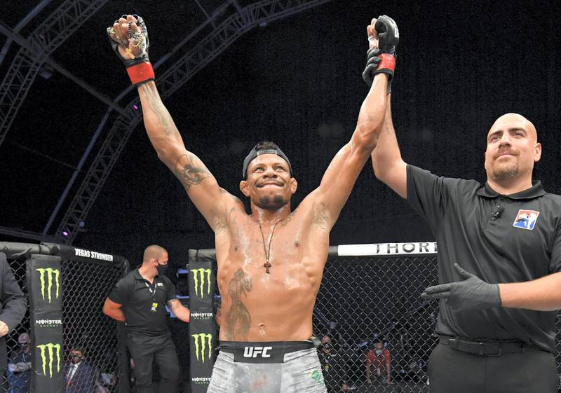 ABU DHABI, UNITED ARAB EMIRATES - JULY 26: Alex Oliveira of Brazil celebrates after his victory over Peter Sobotta of Poland in their welterweight fight during the UFC Fight Night event inside Flash Forum on UFC Fight Island on July 26, 2020 in Yas Island, Abu Dhabi, United Arab Emirates. (Photo by Jeff Bottari/Zuffa LLC via Getty Images)