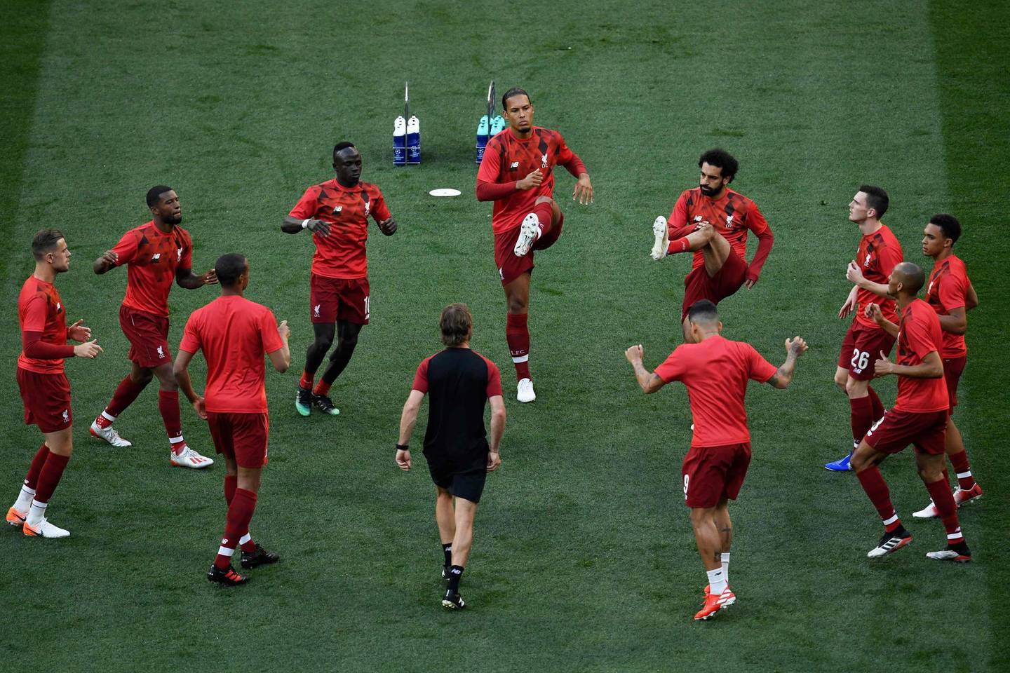 Liverpool's players warm up prior to the start of the UEFA Champions League final football match between Liverpool and Tottenham Hotspur at the Wanda Metropolitan Stadium in Madrid on June 1, 2019. / AFP / PIERRE-PHILIPPE MARCOU