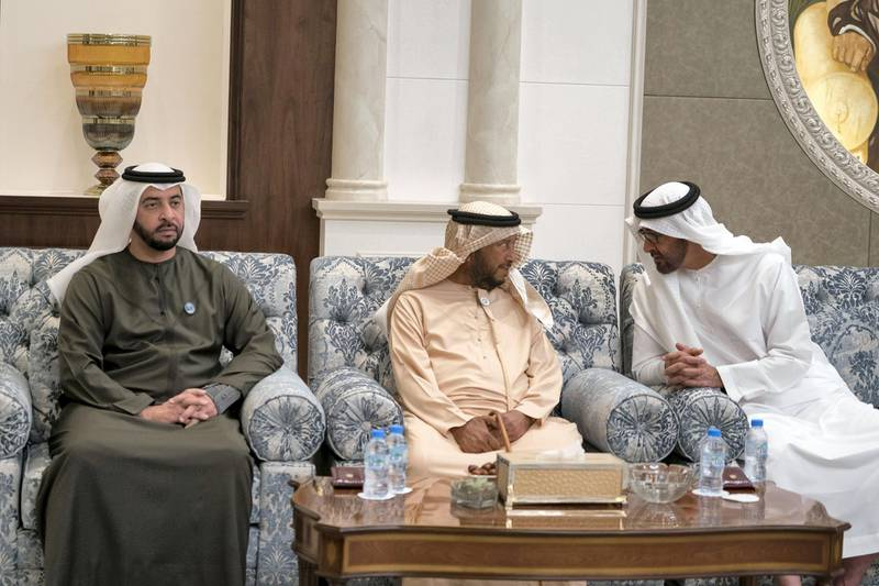 ABU DHABI, UNITED ARAB EMIRATES - January 30, 2018: (R-L) HH Sheikh Mohamed bin Zayed Al Nahyan, Crown Prince of Abu Dhabi and Deputy Supreme Commander of the UAE Armed Forces, HH Sheikh Sultan bin Zayed Al Nahyan, UAE President's Representative and HH Sheikh Hamdan bin Zayed Al Nahyan, Ruler's Representative in Al Dhafra Region, receive mourners who are offering condolences on the passing of HH Sheikha Hessa bint Mohamed Al Nahyan, at Mushrif Palace.  ( Mohamed Al Hammadi / Crown Prince Court - Abu Dhabi ) ---