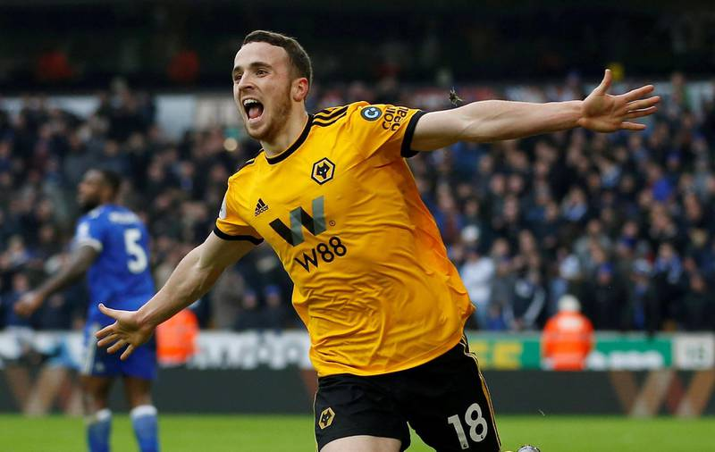 """Soccer Football - Premier League - Wolverhampton Wanderers v Leicester City - Molineux Stadium, Wolverhampton, Britain - January 19, 2019  Wolverhampton Wanderers' Diogo Jota celebrates scoring their fourth goal to complete his hat-trick   Action Images via Reuters/Craig Brough  EDITORIAL USE ONLY. No use with unauthorized audio, video, data, fixture lists, club/league logos or """"live"""" services. Online in-match use limited to 75 images, no video emulation. No use in betting, games or single club/league/player publications.  Please contact your account representative for further details.     TPX IMAGES OF THE DAY"""