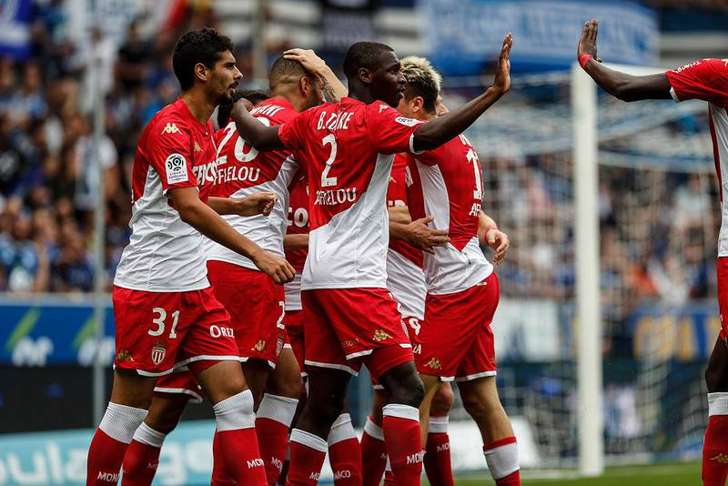 Monaco's team celebrate their first goal during the French League One soccer match between Strasbourg and Monaco in Strasbourg, eastern France in Strasbourg Eastern France (AP Photo/Jean-Francois Badias)