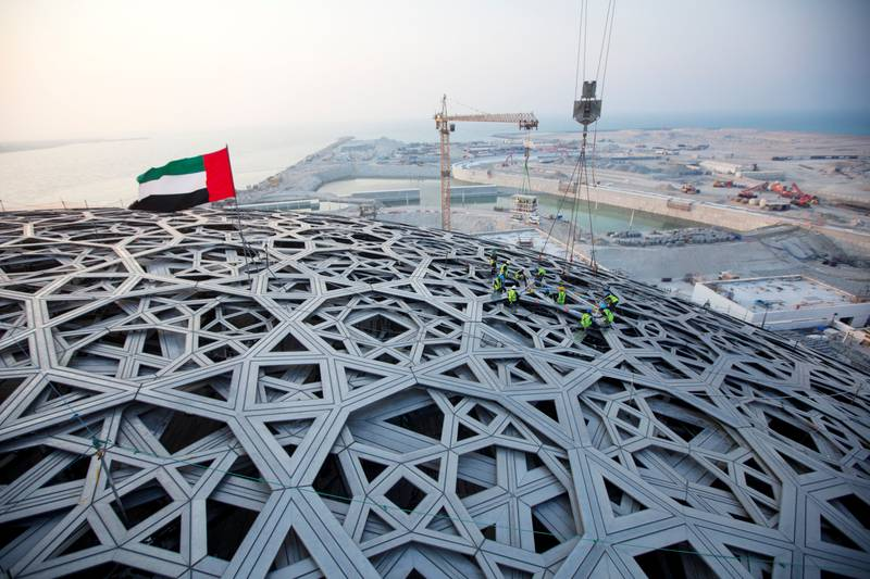 Abu Dhabi, United Arab Emirates, September 17, 2015:     The last piece of the roof is put into place at the Louvre construction site on Saadiyat Island in Abu Dhabi on September 17, 2015. Christopher Pike / The NationalReporter: Nick LeechSection: Louvre *** Local Caption ***  CP0917-Louvre24.JPGNa28se-Louvre1.JPG Na28se-Louvre1.JPG