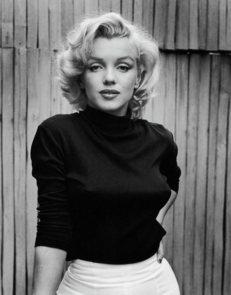 Portrait of American actress Marilyn Monroe (1926 - 1962) as she poses on the patio outside of her home, Hollywood, California, May 1953. (Photo by Alfred Eisenstaedt/The LIFE Picture Collection via Getty Images)
