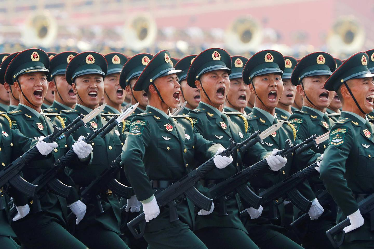 Soldiers of People's Liberation Army (PLA) march in formation during the military parade marking the 70th founding anniversary of People's Republic of China, on its National Day in Beijing, China October 1, 2019.  REUTERS/Thomas Peter