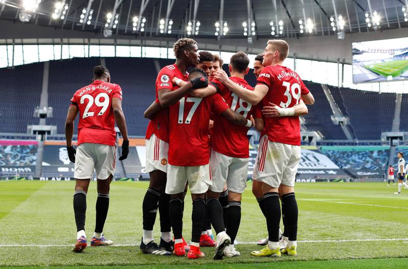 LONDON, ENGLAND - APRIL 11: Fred of Manchester United celebrates with Paul Pogba, Bruno Fernandes and Scott McTominay after scoring their team's first goal during the Premier League match between Tottenham Hotspur and Manchester United at Tottenham Hotspur Stadium on April 11, 2021 in London, England. Sporting stadiums around the UK remain under strict restrictions due to the Coronavirus Pandemic as Government social distancing laws prohibit fans inside venues resulting in games being played behind closed doors. (Photo by Adrian Dennis - Pool/Getty Images)