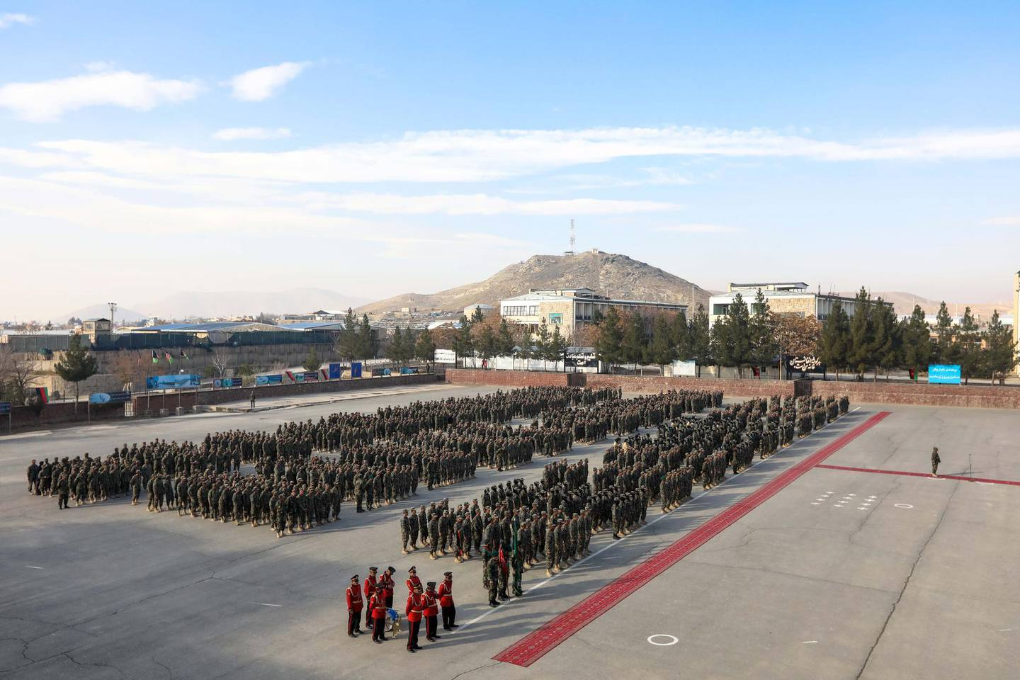 epa08850946 Afghan National Army soldiers stand in attention during their graduation ceremony at the military academy in Kabul, Afghanistan, 29 November 2020. At least 1279 Afghan soldiers including 200 female soldiers were graduated after three months of training.  EPA/HEDAYATULLAH AMID