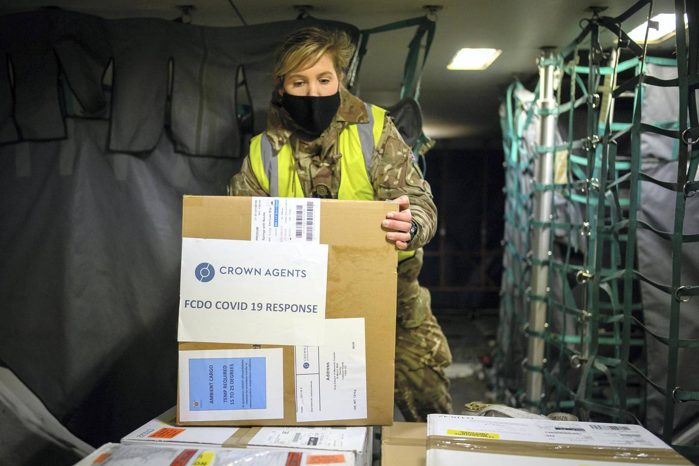 BRIZE NORTON, ENGLAND - FEBRUARY 01: RAF personnel load a batch of the Covid-19 vaccine onto a Voyager aircraft bound for the Falkland Islands at RAF Brize Norton on February 01, 2021 in Brize Norton, England. The British armed forces are handling delivery of the first batch of the Oxford-AstraZeneca Covid-19 vaccines to the residents of the Falkland Islands, with a flight leaving RAF Brize Norton in the early hours of February 1, 2021. The British military operation to support the Foreign Commonwealth and Development Office is addressing the COVID-19 pandemic overseas, primarily in the British Overseas Territories, such as the Falkland Islands, the Ascension Islands and Gibraltar. (Photo by Leon Neal/Getty Images)