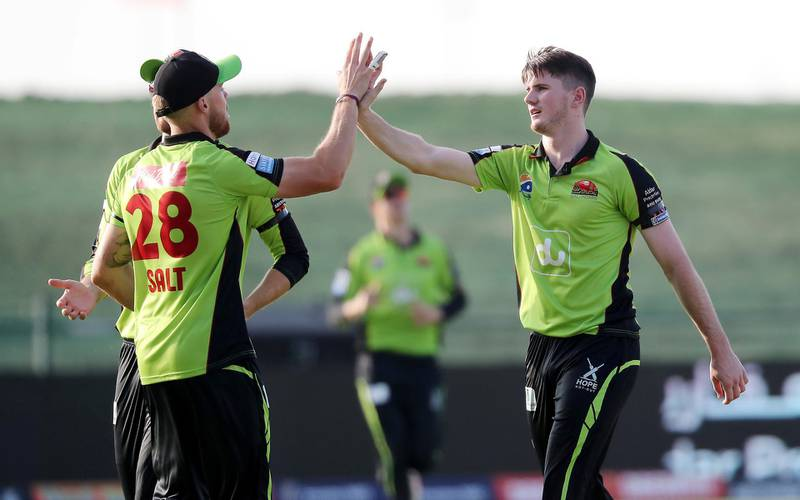 ABU DHABI , UNITED ARAB EMIRATES , Nov 19 – 2019 :- George Garton (right) of Qalanders celebrating after taking the wicket of Dan Lawrence during the Abu Dhabi T10 Cricket match between Qalanders vs Deccan Gladiators at Sheikh Zayed Cricket Stadium in Abu Dhabi. He took 3 wickets in this match. ( Pawan Singh / The National )  For Sports. Story by Paul